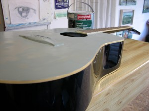 Chris Maher stripped and sanded the guitar for me, I added a coat of acrylic primer.